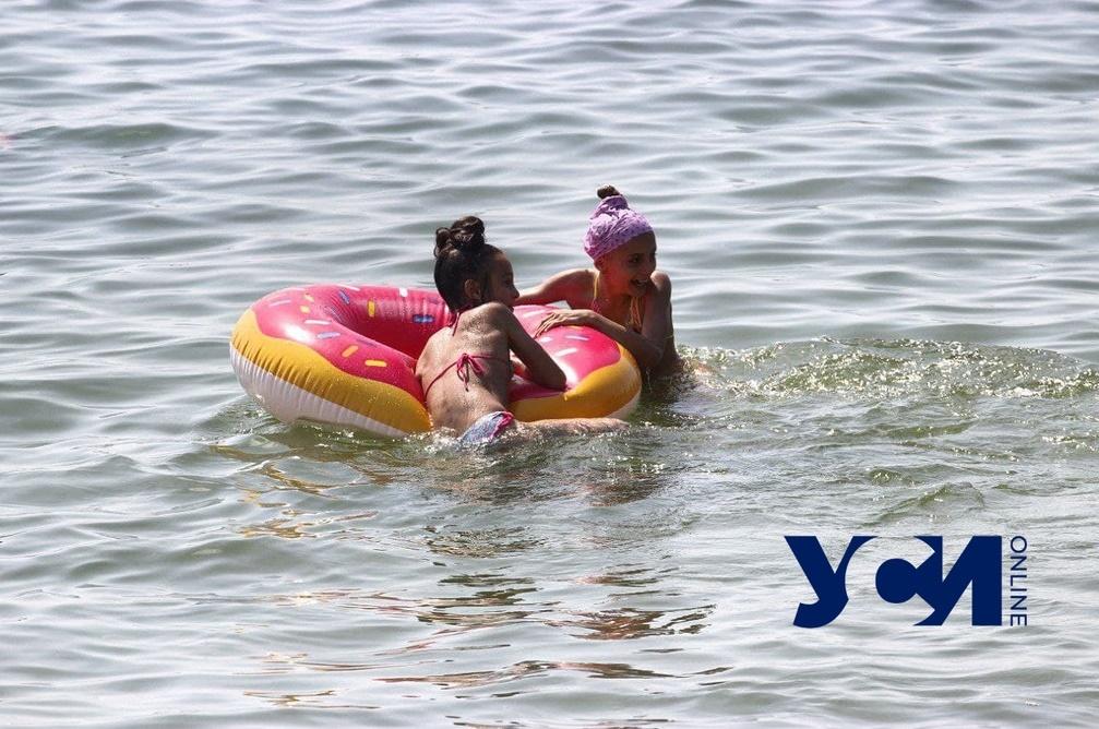 Морская нега, круг-пончик и счастливые люди: пляжи Одессы в разгар лета (фото) «фото»